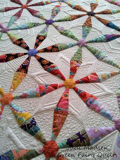 Spring Wheels quilted by Judi Madsen of Green Fairy Quilts!  I cannot get enough of this quilty texture!