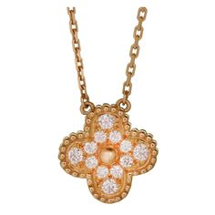 VAN CLEEF & ARPELS Vintage Alhambra Diamond Gold Pendant Necklace | From a unique collection of vintage chain necklaces at http://www.1stdibs.com/jewelry/necklaces/chain-necklaces/