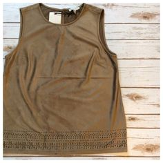 """Faux Suede laser cut top Beautiful top in a rich coffee color with laser cut detailing along bottom hem. Sleeveless with simple single button at back of neck for easy on/off. Darts at bust create shape, waist is loose and non-restricting. Feels and looks like suede without the heaviness of real leather. Perfect unworn condition. Size M - fits generous. Measurements when laying flat: 19"""" chest and 24.5"""" total length. Tops"""