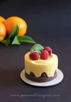 Chocolate cakes with mango mousse and raspberries