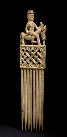 Africa | Comb from the Edo people of Benin City, Edo State, Nigeria | Elephant ivory; carved with horseman in sixteenth-century costume on top.