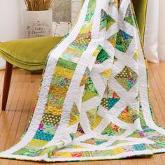 The GO! Signature Block (55356) and triangle dies make a colorful trellis with flowers and greenery peaking through.  Imagine this quilt on your bed or on a porch swing.Compatible with these fabric cutters:GO! BabyGO!GO! BigStudio**Must use with GO! Die Adapter