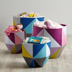 Meet a softer, kinder, gentler kind of quartz.  Crafted from felt pieces and sewn into prism like configurations, no two sides of these felt floor bins are the same.