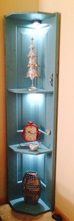 Corner shelf made from an old door
