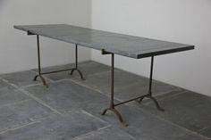A C19th patchwork zinc top trestle table                                                                                                                                                                                 More
