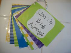 Line Up Sing Alongs - she laminates them, puts them on a ring and hands near the door. Great idea!