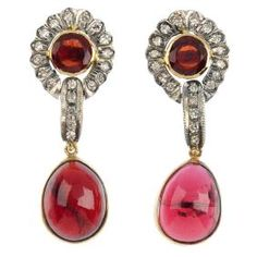Lot: A pair of garnet and diamond earrings. Each designed as, Lot Number: 0183, Starting Bid: £400, Auctioneer: Fellows, Auction: Jewellery, Date: July 6th, 2017 CDT