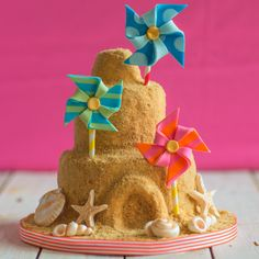 Oh we do like to be beside the seaside! This quirky sandcastle cake is really fun to bake and decorate with kids and is a great summery addition to garden parties or BBQ. The full delicious recipe can be found on BakingMad.com