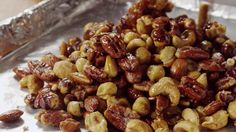 This zesty mix owes its flavor to a blend of sugar, ginger, cinnamon, cloves, and cayenne pepper. Nuts are better when they're crispy and cool, so allow them to stand for at least an hour before the potluck starts./