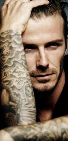 David Beckham David Beckham David Beckham...oy~~~ makes me want to cry he's so pretty! (sigh)