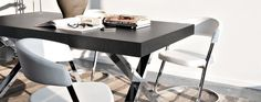 http://www.calligaristoronto.ca/products/dining/extendable-tables/axel/wood-and-metal-x-frame-extendable-dining-table