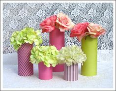 This DIY scrapbook paper vase is a cheap and colorful way to create lots of chic wedding detail and impact. Find this and many more diy wedding centerpiece ideas, tips and tools.