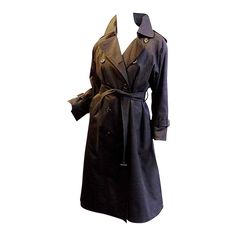 Burberry London's black gabardine long  trench coatwith lining | From a collection of rare vintage coats and outerwear at https://www.1stdibs.com/fashion/clothing/coats-outerwear/