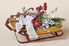 "12""L x 5 1/2""W Wooden Sled with Faux Pine, Red Berries, a White Snowflake and a White Bow, From the Snowy Christmas Collection"