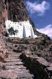 the road and the gate to the monastery. Chosoviotissa was built in 1048 (?) to shelter a mosaic icon of the Panaghia(Amorgos-  Greece)