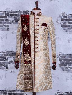 Shop Cream designer wedding wear achkan sherwani online from India. Sherwani For Men Wedding, Wedding Dresses Men Indian, Groom Wedding Dress, Sherwani Groom, Mens Sherwani, Wedding Suits, Wedding Wear, Punjabi Wedding, Indian Weddings