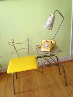 Retro Phone Chat Chair....have one that is made of wrought iron and formica on table with the yellow leather seat. Gramma used it for her telephone. 60's vintage, made by my great uncles who had a wrought iron furniture business.