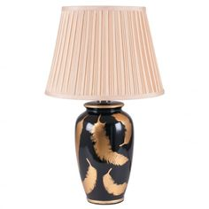 Traditional in shape with a modern twist. This ceramic pot lamp is striking with metallic gold printed leaf design against a gloss black background. This beautiful lamp will be a talking point in any homeDimensions: Lighting Online, Home Lighting, Gold Feathers, Feather Pattern, Ceramic Table Lamps, Gold Print, Leaf Design, Lampshades, Living Spaces