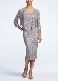 You'll never have to sacrifice fashion for comfort again with this delicate lace 3/4 sleeve jacket dress! Sleeveless dress features all love stretch lace detail. Tea length skirt is chic and demure. 3/4 sleeve jacket provides just the right amount of coverage. Fully lined. Back zip. Imported nylon/spandex/poly blend. Hand wash cold.