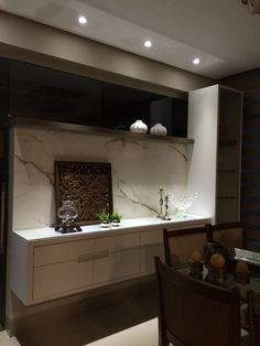 Residência CJ: detalhe de aparador em sala de jantar