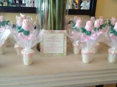 White chocolate flowerpot with pretzels inside and a white chocolate rose, dyed pink. decorated with  pink sugar pearls
