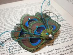 #peacock feather hair clip, to die! $16.00