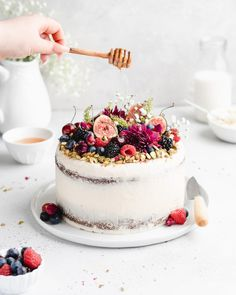 This Pistachio Cake recipe comes complete with a Honey Rosewater Buttercream to compliment their nutty flavors from the pistachios! #cake #pistachio #honey