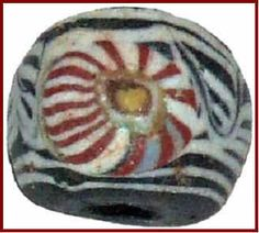 Feather pattern bead with mosaic cane. Islamic Period. via Ancient Beads World.