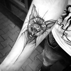 A great cat tattoo design inked on the man's forearm. The piece is made in sketch style.