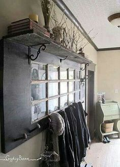 Another use for an old door...a cool coat rack!