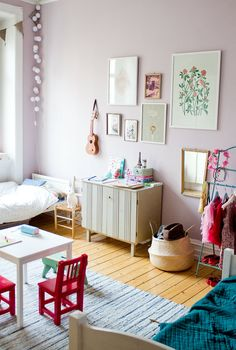 Color, dress up clothes, children's furniture. This room nails it.