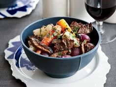To layer the flavors in this dish, chef Rory Herrmann at Bouchon in Beverly Hills marinates beef short ribs and vegetables in red wine overnight, then uses the marinade in the braise as well. Spring vegetables help lighten the rich stew. More Hearty Stews Wine Recipes, Beef Recipes, Cooking Recipes, Recipies, Cooking Food, Top Recipes, Cooking With Red Wine, Rib Meat, Beef Short Ribs