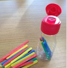 Put Popsicle sticks in water bottle. This works in fine motor skills.