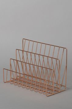 This stylish rose gold coloured wire letter rack would be perfect for organising your desk space!