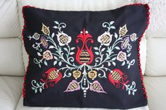 Stunning original Vintage Antique hand embroidered black pillowcase . A HEIRLOOM piece of European Nostalgia Hungarian Folk Art . One of a kind black pillow cover The embroidery is of a floral design in bright colors against a black background. The back is a dark black with snaps for closing on one side. This Hand embroidered vintage decorative pillowcase is from an ethnic area in Hungary, Europe . Condition: Excellent ,the central floral has a few inside small stitches missing but these do…