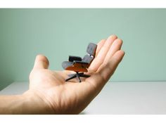 3D Printed Eames Lounge Chair by Kevin Spencer Designer Kevin Spencer has created a miniature of the classic Eames Lounge Chair brought to life with 3D colour printing. Even includes the Ottoman! remember subscribe  - Original post: http://pinterest.com/pin/149041068891241060/