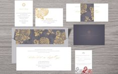 This personalized stationery has a modern floral theme with grey and white as base colors and roses printed in gold. Wedding Stationery, Wedding Invitations, Laser Cut Box, Personalized Stationary, Indian Wedding Cards, Floral Theme, Table Cards, Wedding Programs, Save The Date Cards