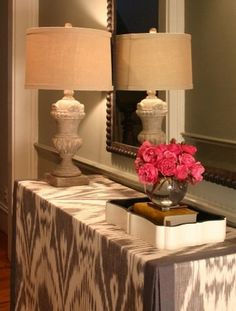 Love the skirted console table.