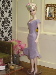 SPRINGTIME IN PARIS, La Trompette:  A simple and lovely day dress in silk noil, fitted through the torso and flaring into a flirty trumpet skirt.  Gathered cap sleeves and a v-neckline complete the silhouette.  This is a new design from Bellissima Couture and is available in pale lavender silk noil lined in pale pink silk taffeta, and pale aqua silk noil lined in mint green silk taffeta.  Each dress comes with a matching band hat with flowers.