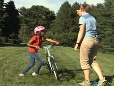 How to teach your child to ride a bike (video)...makes sense!  No training wheels to use as a crutch ;-)