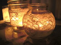 use vintage lace to wrap various sizes of votives and hurricanes