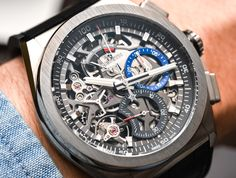 Hands-On with the Zenith Defy El Primero 21, skeletonized and non-skeletonized dial. With a 1/100th-of-a-second chronograph, power reserve indicator at 12 o'clock and a new modern look.