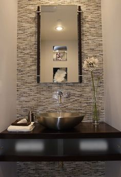 Love mirror. In reflection of mirror you can see indented shelves in the wall with mirrored background & sculptress inside, absolutely love that idea and it is a must :)