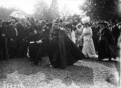 King George V and Queen Mary walking in the grounds of Maynooth College (St Patrick's College) in Maynooth, County Kildare, during a visit to Ireland, July 1911. From left to right, His Grace, the Most Reverend Dr. Daniel Mannix (President of the College), the King, His Eminence Cardinal Michael Logue, Primate of All Ireland, the Queen, and His Grace, the Most Reverend Dr. William Walsh, Archbishop of Dublin. (Photo by Topical Press Agency/Hulton Archive/Getty Images)