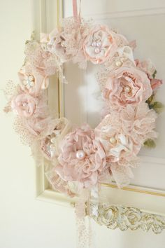 This listing is for one beautiful handmade ribbon work wreath by Jennelise Rose. This one of a kind wreath is covered with handmade flowers in shades of blush, peachy pink, cream and ivory with lace, tulle, silk, and netting. It is dotted with pearls and has hanging lace, silk and tulle ribbons. The back is also finished with ivory crochet lace. Wreath measures approx. 7 1/2 wide and hangs from a dusty rose French ribbon. An utterly unique and romantic decoration! IF YOU WISH TO PURCHASE...