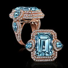 Rose Gold Blue Topaz and White Diamond Ring, Influences of opulence and grandeur are captured in this combination of linear and round cut gems creating the contemporized feel of an elegant era.    A unique triple tier of precision set Diamonds surround a centre Emerald cut Blue Topaz, grandly flanked by draping Pear cut stones of Aquamarine for a stunning adornment.