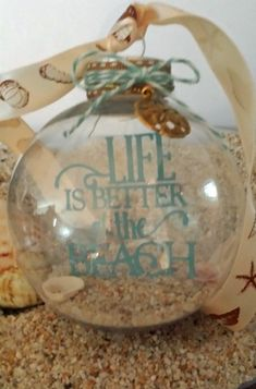 This will be a great keepsake from our PR trip! - Ornament - life is better at the beach. This is a floating ornament with the sentiment from Silhouette cut out of vinyl and placed on a transparency. Inside the ornament is sand and shells. Beach Ornaments, Diy Christmas Ornaments, Christmas Projects, Holiday Crafts, Christmas Decorations, Shell Ornaments, Clear Ornaments, Christmas Ideas, Coastal Christmas