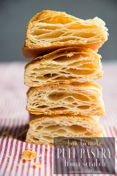 A stack of baked Puff Pastry strips cut to reveal its layers