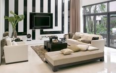 Inspiring White Living Room Chairs with Wooden Black Table on the Comely Rug Plus Black and White Wall Paint Color Also Completed with Wall Flatscreen TV Decoration Ideas