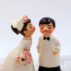 This bride and groom vintage ceramic figurines are the perfect wedding decoration for a cake, bride and groom table centerpiece or any other wedding décor you can think of. Each doll is hand painted to give it a unique and different look, each doll is an original creation. Measurements: The bride is 15 cm/ 6 inch tall and 7cm/2.7 inch wide. Groom is 15 cm/ 6 inches height and 6cm/ 2.3 inches wide. The price is for a pair, bride and groom. I pack all of my creations very sa...